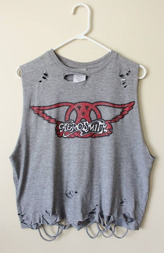 This shirt is a one of a kind, each shredded shirt is different.  This one is a gray Aerosmith tank top, all cotton.  It has distressing strategically placed all over the shirt including the collar, front, back and the bottom hem.  Heres your info on it -  - Size Small  - Across chest flat, pit to pit -21 (42 around)  - Shoulder seam down - 21  If you need more info or have any questions, just yell, were around to help you out.  If youre ordering from a location not listed, message us and…