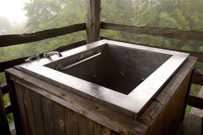 """STAINLESS STEEL JAPANESE BATH WITH GRAB BAR   36"""" x 48"""" x 32""""   The Swag Country Inn, NC    Like the one above, Japanese bathtubs are deep to allow water to stay warmer longer."""