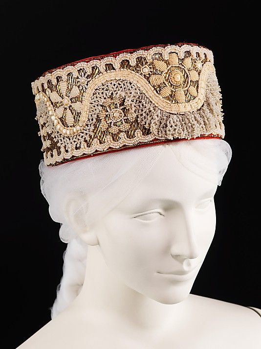 Headdress, early 19th century.  Russian Glass, metal, cotton, mother-of-pearl. Headdresses, or kokoshniks had the greatest abundance of ornamentation of any type of garment in Russia. They were most often made of damask woven with gilt metallic threads or velvet with gold embroidery.