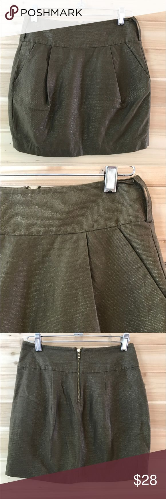 """[Armani Exchange] Green & Gold Mini Skirt Armani Exchange Sz 0 green skirt. Pretty gold threaded throughout. Pockets and pleats. Very good condition.   15"""" long 12.5"""" waist flat Armani Exchange Skirts Mini"""