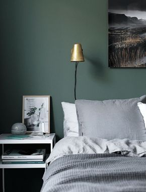 Moody green bedroom
