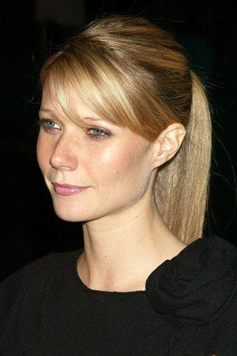 Sleek pony and a sweeping side fringe. Polished look from Gwyneth Paltrow