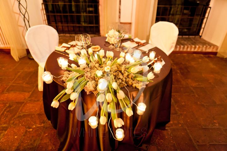 White tulips and little candles in a winter wedding