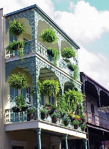 Beautiful balcony on Bourbon Street. New Orleans.  Time to hang out those ferns!