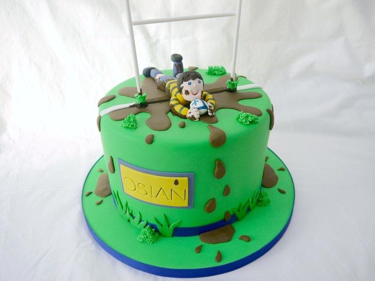 Rugby Cake! A rugby themed cake for a rugby made little boy! The cake inside is a red, green and white layer cake, the colours from the Welsh flag!  Good idea for kids birthday party
