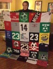 """Lea Lewkowski ordered three Project Repat t-shirt quilts for holiday gifts. The first two wereHanukah gifts, """"This one is for my soccer nut of a kid! He's play"""