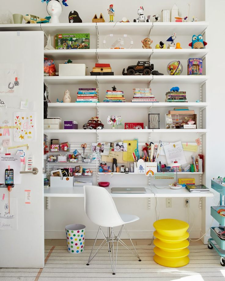 Love the Elfa white shelves from the Container Store and the IKEA utility cart. This is actually a kids' workspace (!!) but it would be awesome for a grown up too. From Tina Roth Eisenberg's house tour on A Cup of Jo.