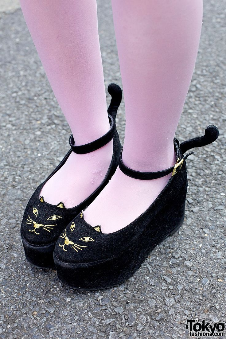 Love Drug Store neko platforms - with tails - on the street in Harajuku.