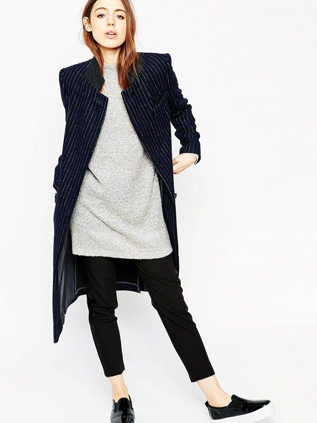 Soften up a menswear-inspired jacket by pairing it with a long sweater, relaxed pants, and platform sneakers