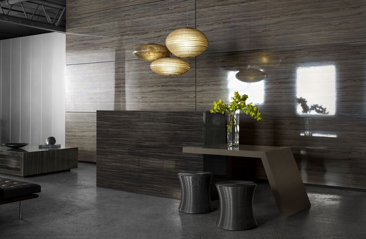 Reception desk and coffee table Laminex DiamondGloss Endula Macassar.Side table Laminex DiamondGloss Elkhorn Midas. Feature wall Laminex DiamondGloss Seductive Limba. Desk Laminex DiamondGloss Dark Wengeblock. Styling Wendy Banister. Photography Earl Carter.