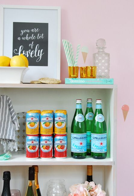 Bookshelf bar cart.  You could put something decorative on the back and turn it around when you aren't using it.  [The Sweetest Digs]