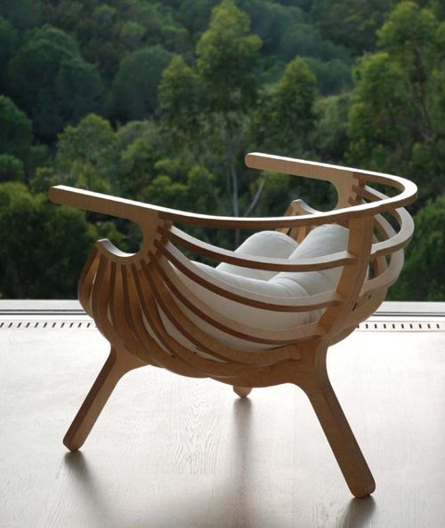 The chair is made of cut and bent plywood, beautifully curved, soft and strong and very unique. Find out more at http://www.branca-lisboa.com/