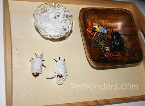 "Insect Wrapping    Children wrap the plastic insects with pieces of white yarn (""spider webs""). When they are finished wrapping all of the insects, they unwrap them and place the yarn back in the bowl. We do this activity during a study of bugs and spiders."