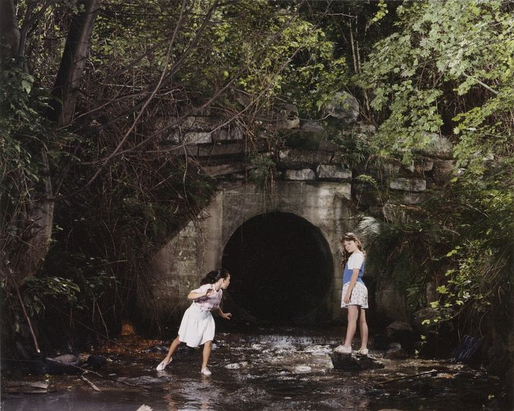 jeff wall 1989 the drain - prepubescent girls, infront of a hole, lots of symbolic sexual ideas here. all set up.