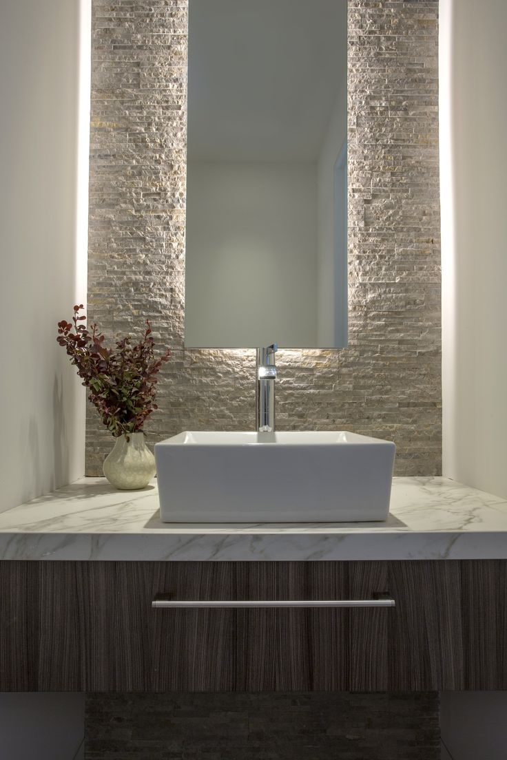 Back Lit Mirror Against Textured Stone Wall Vessel Sink