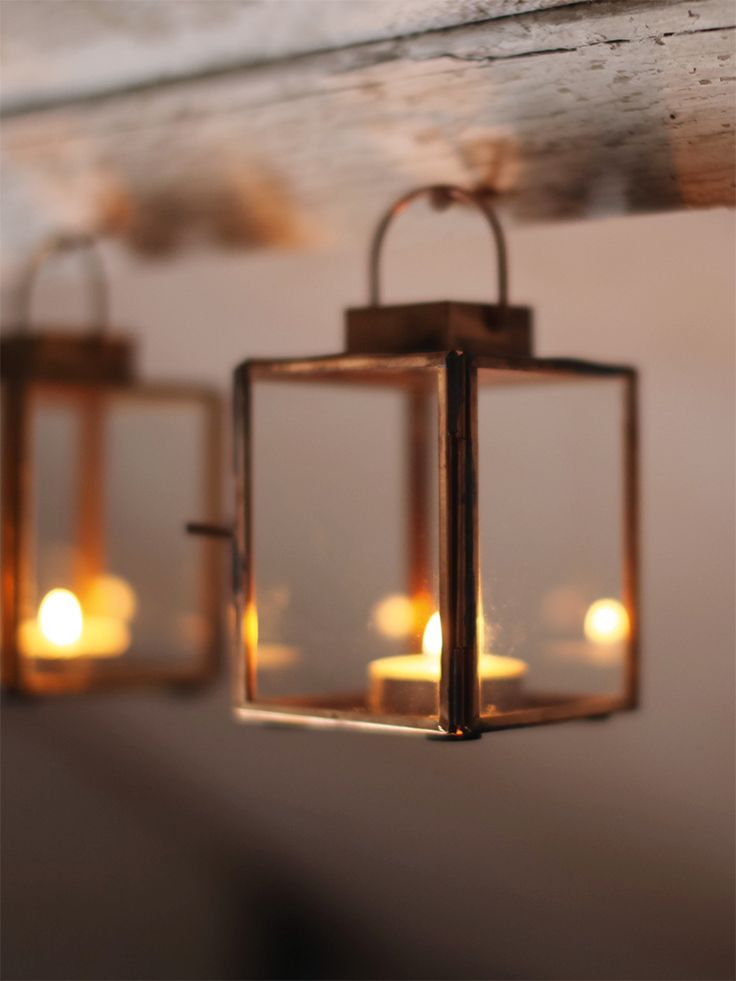 Made from quality glass with delicate copper coloured edges and top, our petite lantern includes a hinged door for adding a tea light and a decorative handle. The perfect match for our Tea Light Candles, why not team three together and display on our Hammered Copper Tray?