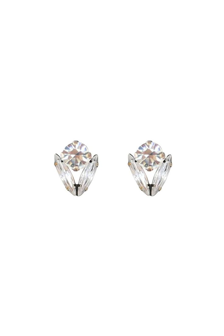 The Arista studs feature crystal navettes surrounding a Swarovksi crystal for a flirty floral shape. The perfect size for all-day earrings. Surgical steel posts, antiqued brass setting and hand set crystals.     Arista Studs by Loren Hope. Accessories - Jewelry - Earrings - Studs Alexandria, Virginia