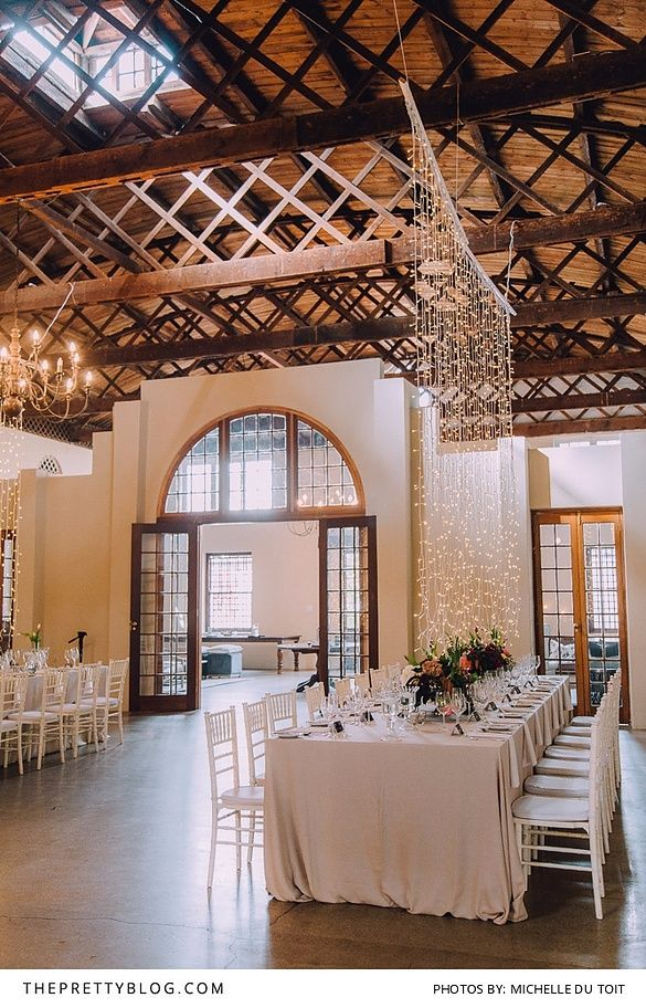 Light wedding venue with long tables and string lights | Venue: Nooitgedacht Estate | Michelle Du Toit Wedding Photography | Wedding Planning & Flowers: Bride Sidekick |