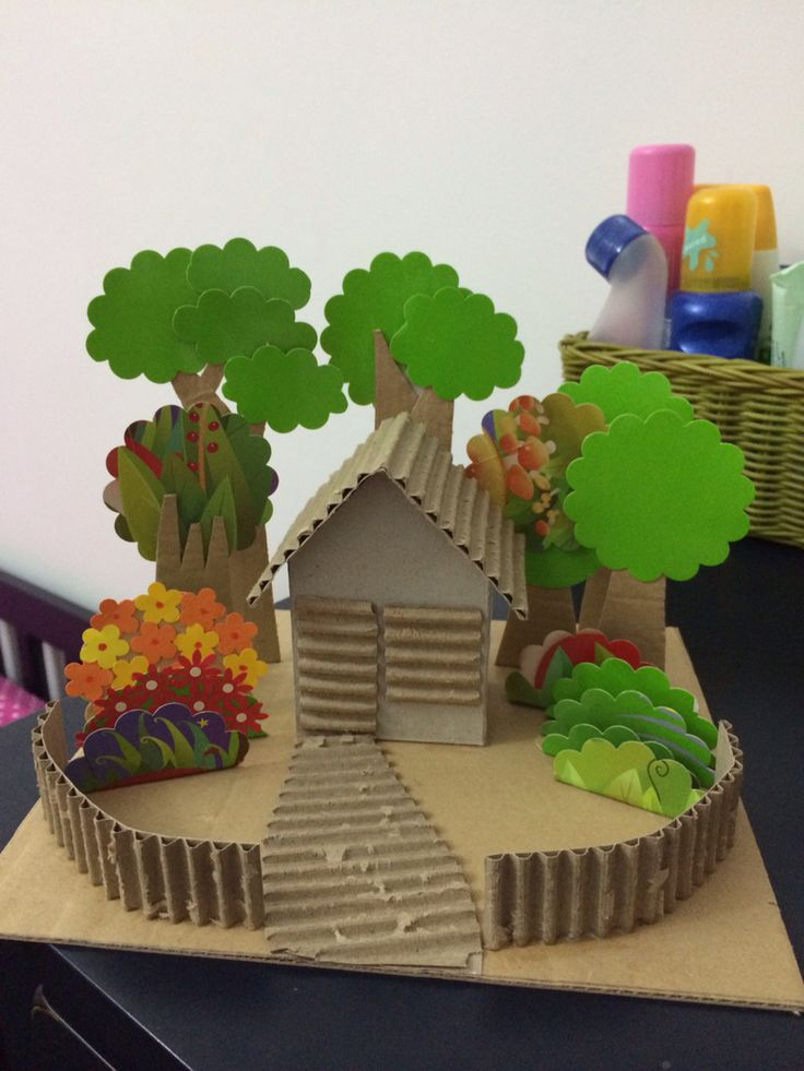 Simple diorama house and garden made of recycled cardboard and cereal Box