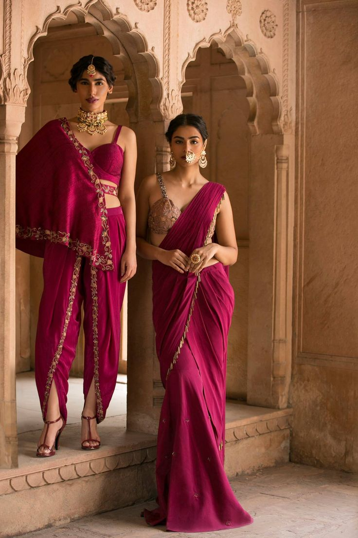 Maroon Embroidered Dhoti and Bustier with One-Shoulder Cape  Shop now at: https://www.perniaspopupshop.com/designers/kazmi-india  #kazmiindia #getthelook #indianfashion #indiandesigner #blackgold #pink #detailing #shopnow #happyshopping #perniaspopupshop  Maroon and Gold Embroidered Pre Stitched Sharara Saree