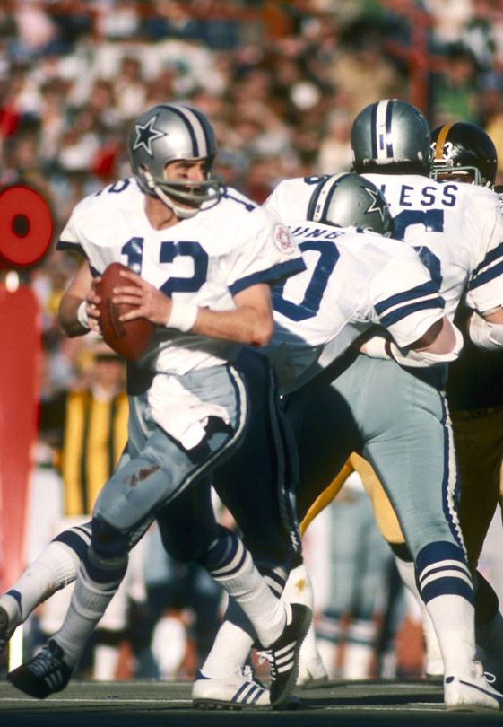 Roger Staubach  Dallas Cowboys.  He was one of the BEST Cowboy players to ever play on the team. Too bad he doesn't coach.