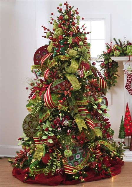 I like the wide ribbon and big ornaments on this tree