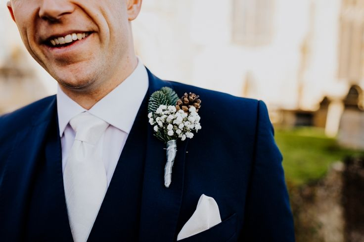 A wintery pine cone and gyp buttonhole for the groom to complement his navy suit and ivory tie and pocket square. Photo by Benjamin Stuart Photography #weddingphotography #groom #weddingsuit #navysuit #buttonhole #pineconebuttonhole #winterwedding