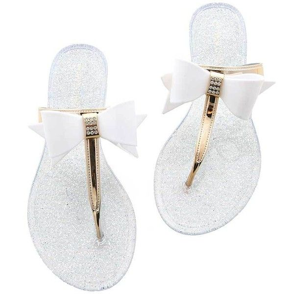 Pink Ice Tuxedo Jelly Flip Flops ($20) ❤ liked on Polyvore featuring shoes, sandals, flip flops, flats, white, glitter flats, pink jelly sandals, white flip flops, jelly flats and flip flop sandals