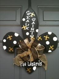 New Orleans Saints Fleur De Lis Door Hanger. OhhhMyyyyyGoooodness! We gots to have one of these with our name on it!