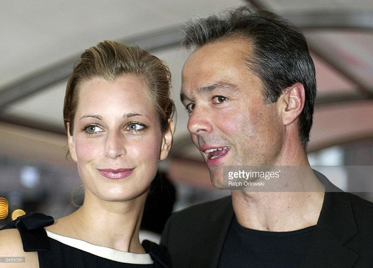 http://media.gettyimages.com/photos/german-actor-hannes-jaenicke-and-his-girlfriend-tina-bordihn-attend-picture-id3455091