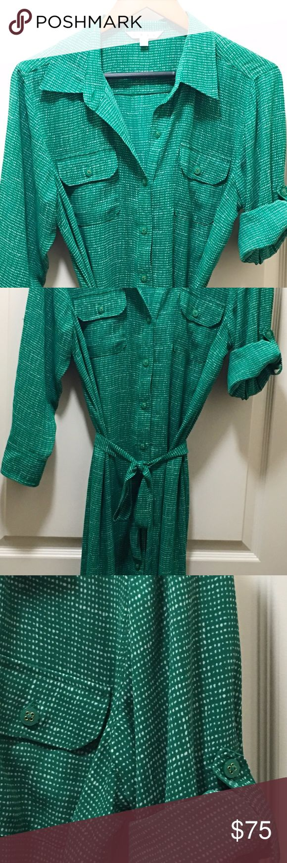 Cabi Emerald Green Shirt Dress Button up shirt dress with 3/4 sleeves when worn down or can be rolled up and secured with a button tab.  Comes with a tie. Can be worn at the office or on the weekends with jeans.  Never worn but tags have been removed. CAbi Dresses