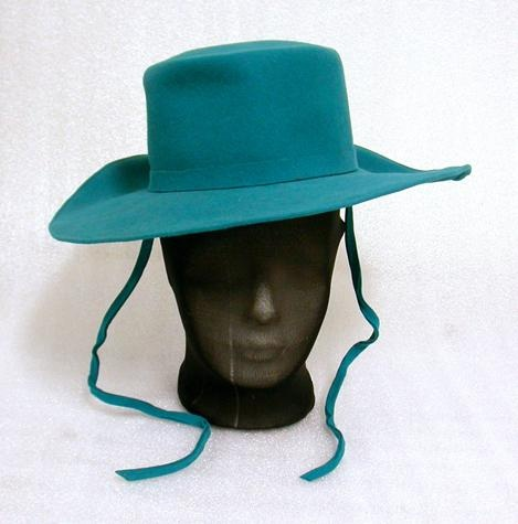 Hat of teal felt - sailor or fedora shape, with flat top. Made in New Zealand. Source: Museum Victoria Via: @museumvictoria