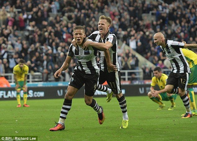 Dwight Gayle celebrates with Matt Ritchie after scoring Newcastle's fourth of the evening