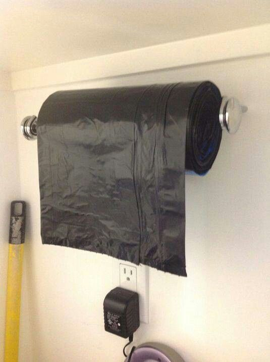 Organize. This is one I never thought of - paper towel roll for holding the trash bags. Cool