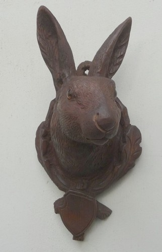 Black Forest carved rabbit head with glass eyes