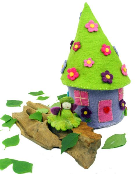 "Let your child's imagination run to the depths of an enchanted forest with this unique and fun fairy house. Includes ""Lemongrass"" Flower Fairy. (As photographed). The roof opens on one side so that fa"
