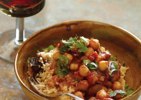 Chickpea and Date Tagine - a delicious North African vegetarian dish with the warmth of cinnamon, cumin, coriander, garlic and ginger along with onions, tomatoes, dates, couscous, chickpeas, lemon juice and cilantro.