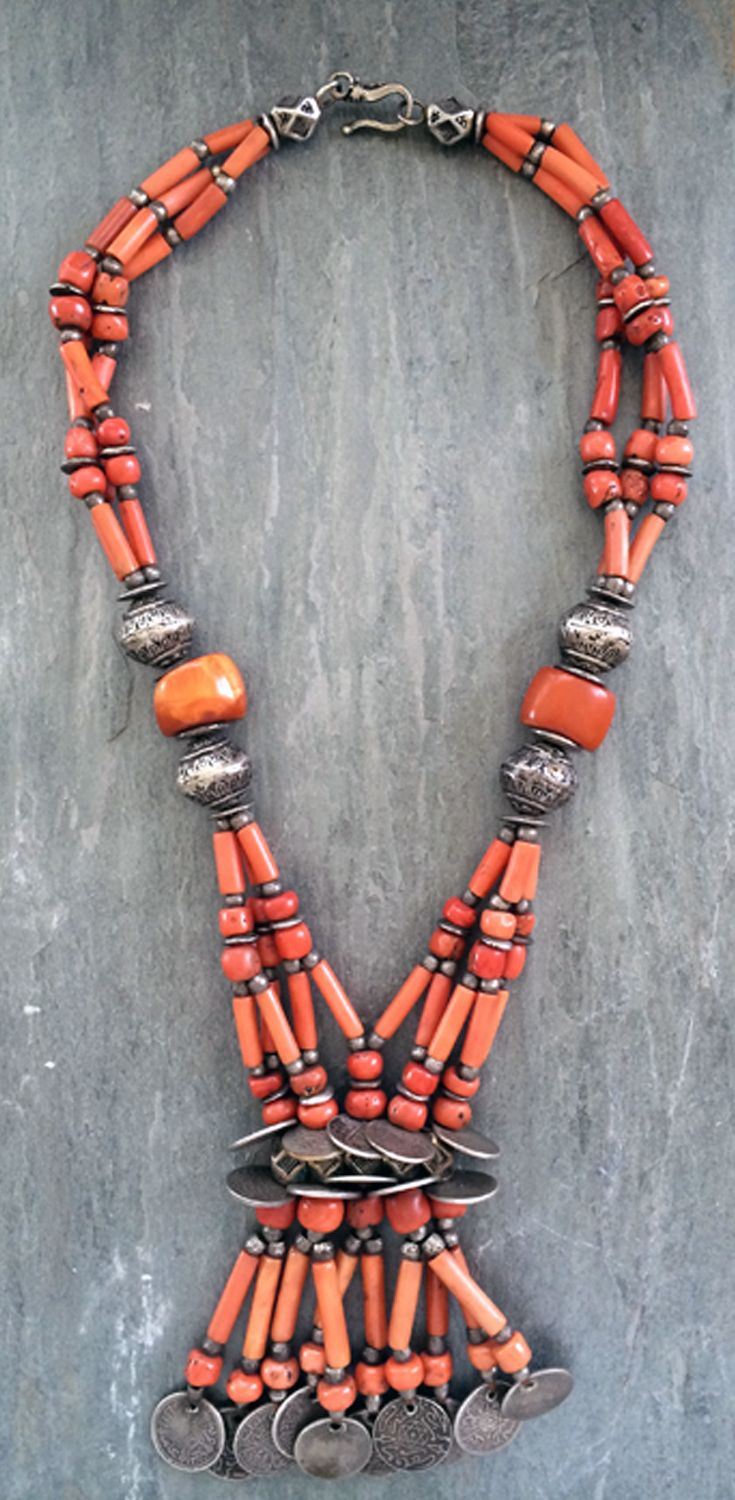 Faouzi Designs | Antique undyed coral beads, matched with four antique Tiznit silver beads from the early 1930s. Tiznit is a town founded in the southern Moroccan region of Souss-Massa-Drâa.  The hexagonal silver beads between the rows of coins are worn by the Tuareg and Saharwi peoples for protection. The coins which finish this piece are all pre-1930. | 4'495$