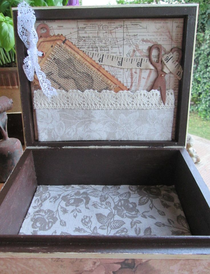 Wooden box, patinated and decorated with scrapbook paper and ornaments, inside fabric...