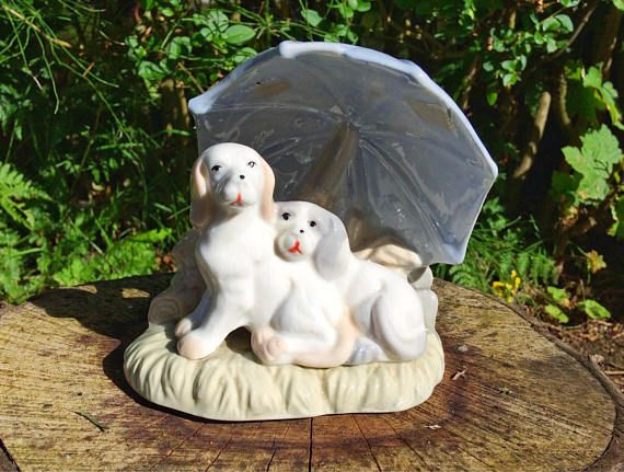 Two dogs under an umbrella figurine / baby blue lladro style