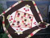 """Cherry on Top Quilt Pattern. There is nothing sweeter than the Cherry on Top…Except maybe this yummy quilt! This fun quilt with dimensional cherries measures approximately 40 1/2"""" x 40 1/2"""". http://www.kayewood.com/item/Cherry_on_Top_Quilt_Pattern/2806 $9.00"""