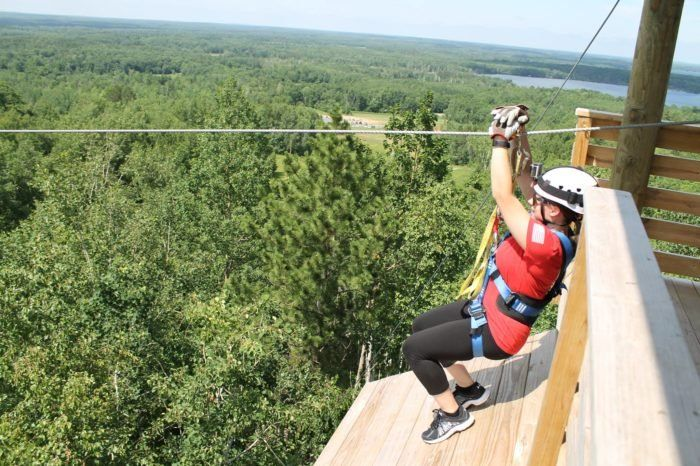 Take A Ride On The Longest Zipline In Minnesota At Kerfoot Canopy Tour Ziplining Minnesota Travel Tours