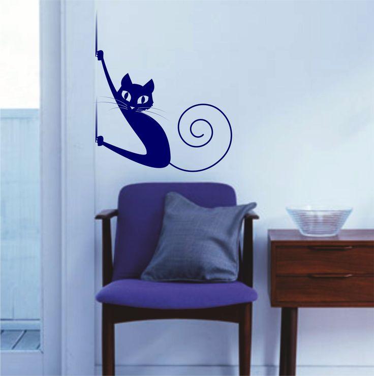 Vinilo decorativo de la silueta de un gato deslizándose con sus garras por la pared.
