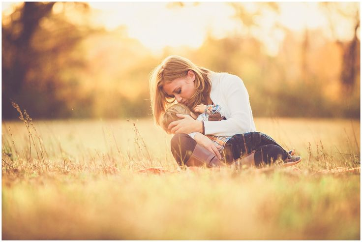 Whimsical and dreamy outdoor portrait of mother breastfeeding in a field at sunset photographed by Massart Photography, RI MA CT