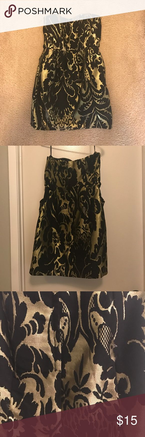 Black and gold night out dress Regal strapless, slight sweetheart neckline short dress. Black and gold, size US8. The dress is form fitting at the top and has pockets on the sides. Dresses Strapless