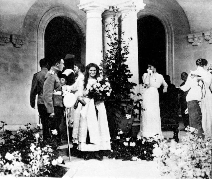 "The Grand Duchesses with their brother Tsarevich Alexei Nikolaevich Romanov  and their mother Empress Alexandra Feodorovna at Livadia. ""AL"""