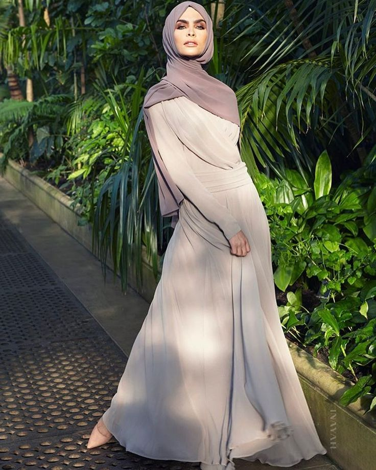 A classic gown featuring delicate pleats to create an elegant and natural flow. Pair with our Soft Crepe Hijabs for the perfect evening look. Warm Sand Draped Gown with Flare Pebble Soft Crepe Hijab - SALE Oatmeal Jersey Drawstring Hijab Cap Large Black Velvet Scrunchy www.inayah.co