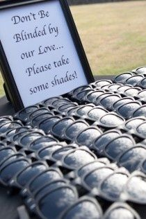 "Pass out inexpensive sunglasses as a wedding favor with a sign that reads ""Don't be blinded by our love... Please take some shades!"" Would be great for a daytime outdoor wedding where the guest might be sitting in the sun or a beach wedding. Then of course there are all the cool opportunities for pictures of your guest wearing their new sunglasses!"