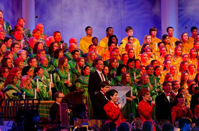Candlelight Processional at Epcot is the telling of the Christmas story by a celebrity narrator with music sung by a mass choir and performed by a 50-piece orchestra