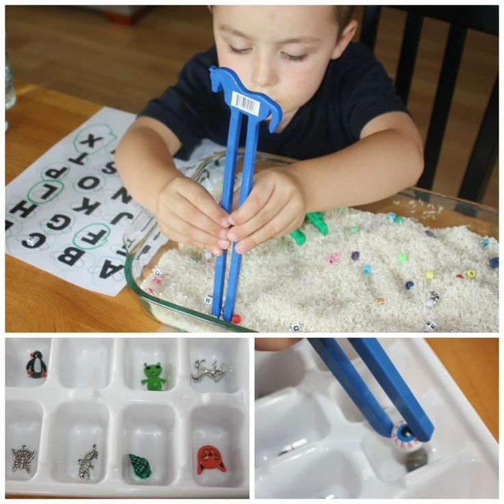 After he found all the letters and matched them, I encouraged him to practice with the chopsticks again (since I didn't push with the letters) and find the other treasures buried in the rice. He was excited to see the kitty, penguin, horse, eyeball and more! For this part of the activity, I had placed an ice cube tray next to the bin and hoped he would have a use for it. The idea was to find an object and place it in the ice cube tray using the chopstics! T